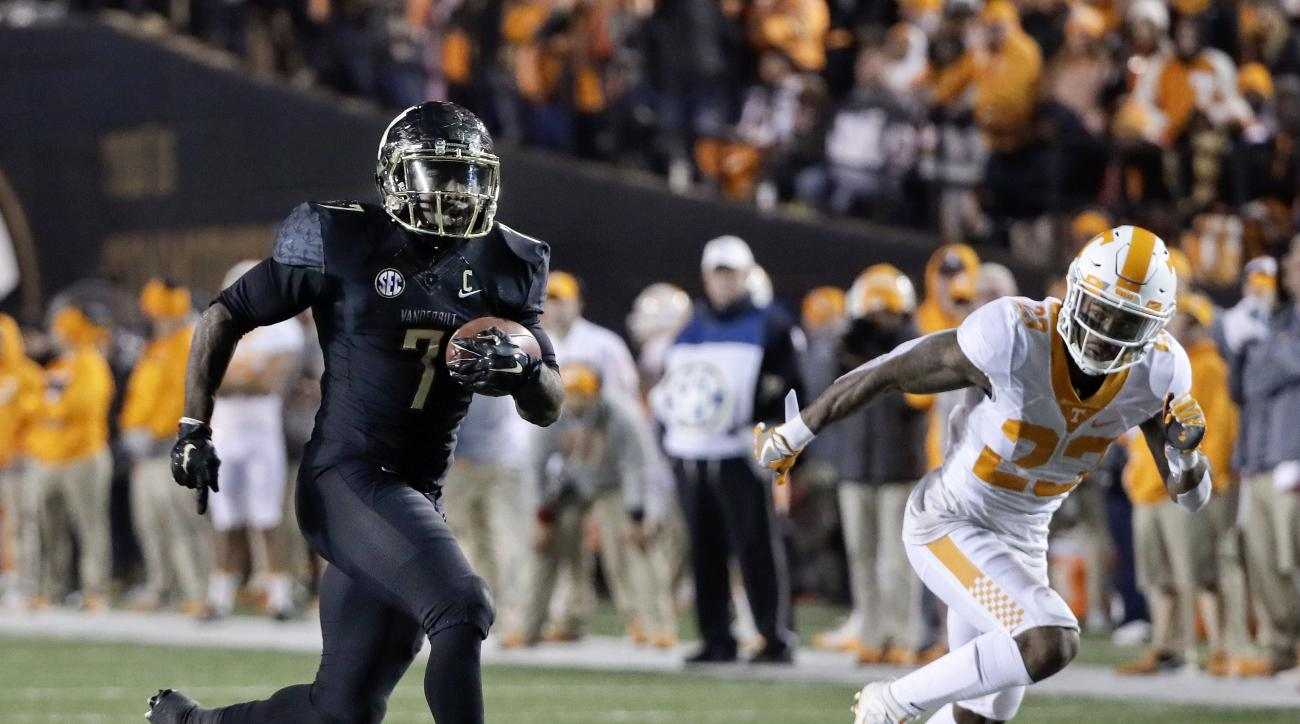 FILE - In this Nov. 26, 2016, file photo, Vanderbilt running back Ralph Webb (7) beats Tennessee defender Cameron Sutton (23) to the end zone for a touchdown during an NCAA college football game in Nashville, Tenn. Webb has already set the school record f