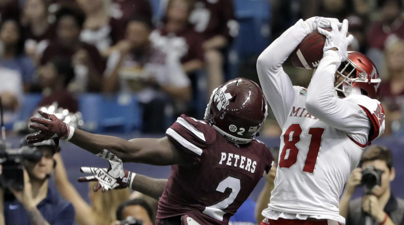 Miami (Ohio) wide receiver James Gardner (81) pulls in a 6-yard touchdown pass in front of Mississippi State defensive back Jamal Peters (2) during the first half of the St. Petersburg Bowl NCAA college football game Monday, Dec. 26, 2016, in St. Petersbu
