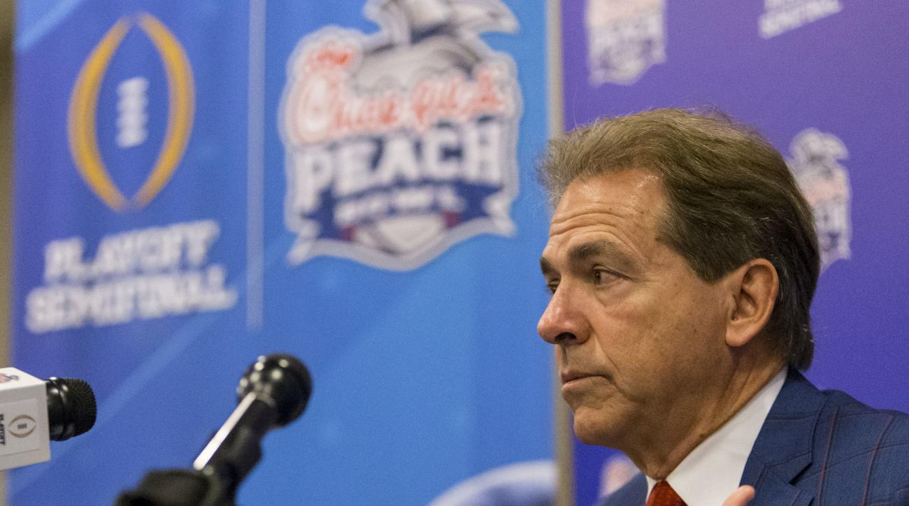 Alabama football coach Nick Saban talks with the media during a Peach Bowl NCAA college football press conference, Monday, Dec. 26, 2016, in Atlanta. Alabama takes on Washington on Saturday, (Vasha Hunt/AL.com via AP)