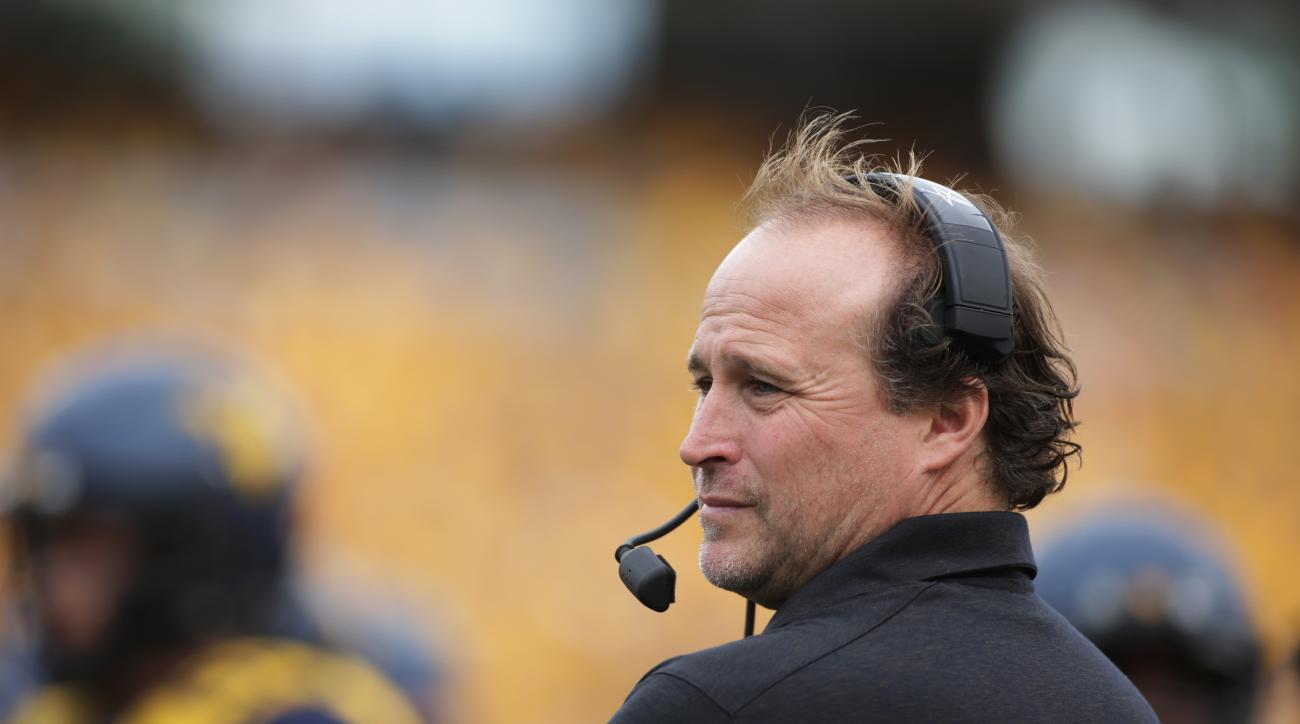 FILE - In this Sept. 26, 2015, file photo, West Virginia coach Dana Holgorsen watches his team play Maryland in an NCAA college football game in Morgantown, W. Va. Miami will play West Virginia in the Russell Athletic Bowl on Wednesday, Dec. 28, 2016, in
