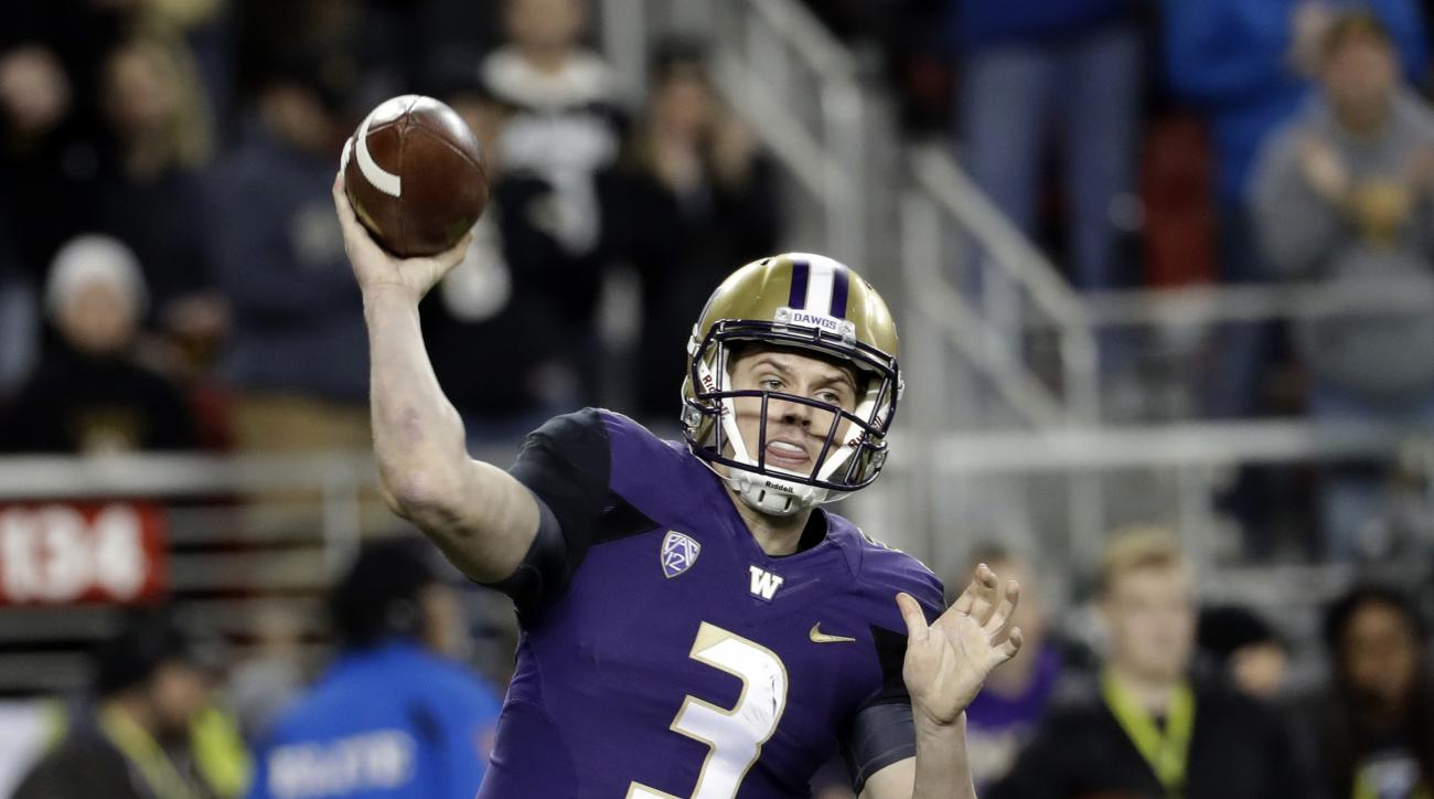 FILE - In a Friday, Dec. 2, 2016 file photo, Washington quarterback Jake Browning (3) throws against Colorado during the first half of the Pac-12 Conference championship NCAA college football game, in Santa Clara, Calif. Browning and wide receiver John Ro