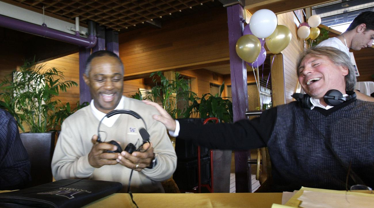 FILE - In a Monday, Oct. 27, 2008 file photo, Washington football coach Tyrone Willingham, left, is given a warm welcome by Rob Rondeau as Willingham arrives for his weekly radio program, in Seattle. In the 38 years since he joined the broadcast team call