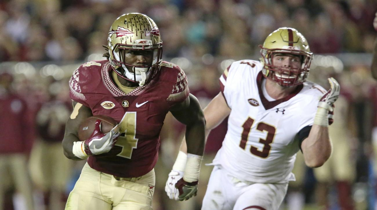 FILE - In a Friday, Nov. 11, 2016 file photo, Florida State's Dalvin Cook turns gets past Boston College's Connor Strachan on his way to a touchdown in the second quarter of an NCAA college football game, in Tallahassee, Fla. The Orange Bowl is a home gam