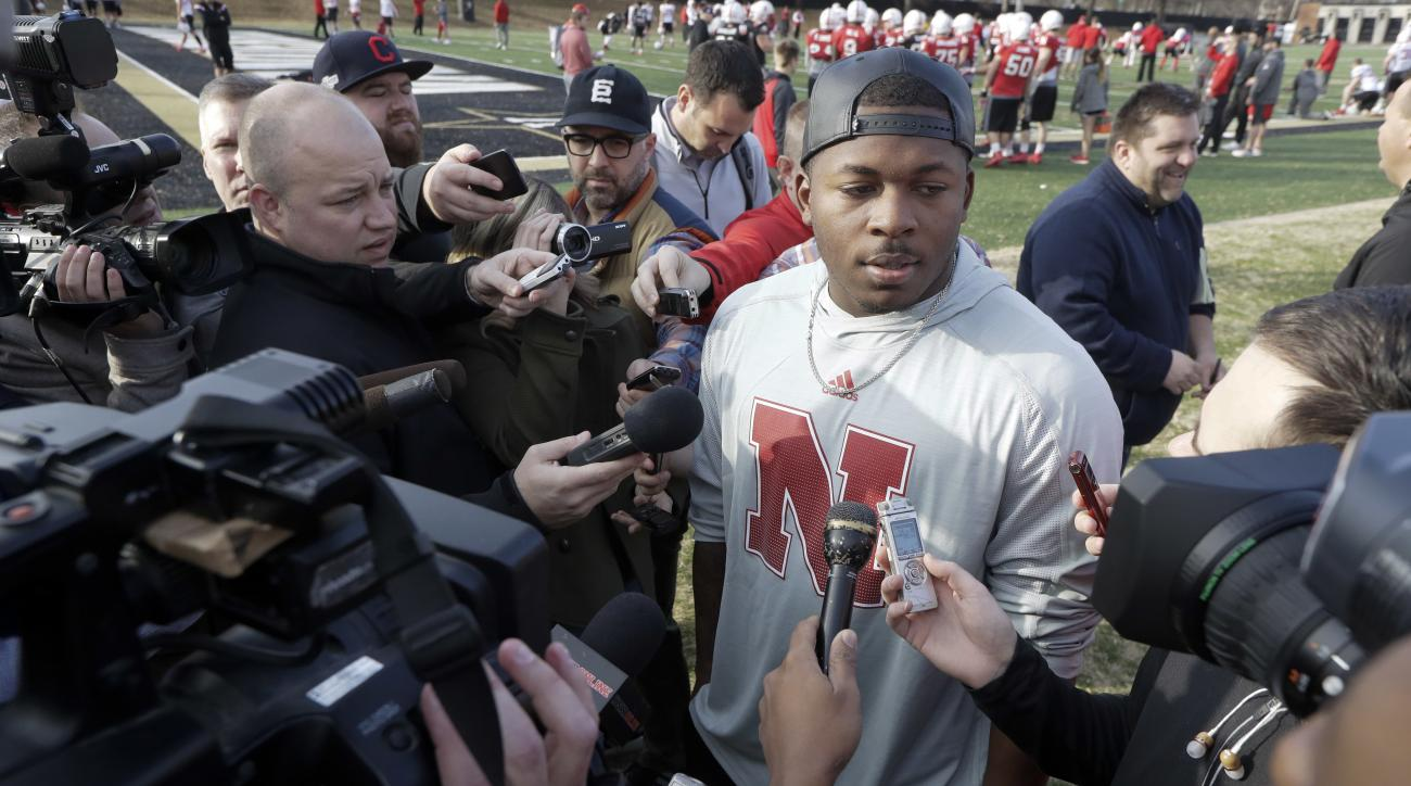 Injured Nebraska quarterback Tommy Armstrong Jr. talks with reporters during practice Wednesday, Dec. 28, 2016, in Nashville, Tenn. Nebraska is scheduled to play Tennessee in the NCAA college football Music City Bowl Friday. (AP Photo/Mark Humphrey)