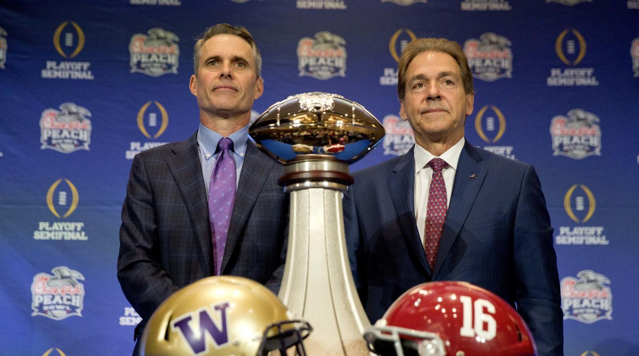 Alabama head coach Nick Saban, right, and Washington head coach Chris Petersen pose for a photo with the trophy during an NCAA college football press conference for the Peach Bowl, Friday, Dec. 30, 2016 in Atlanta. Washington plays Alabama on Saturday. (A