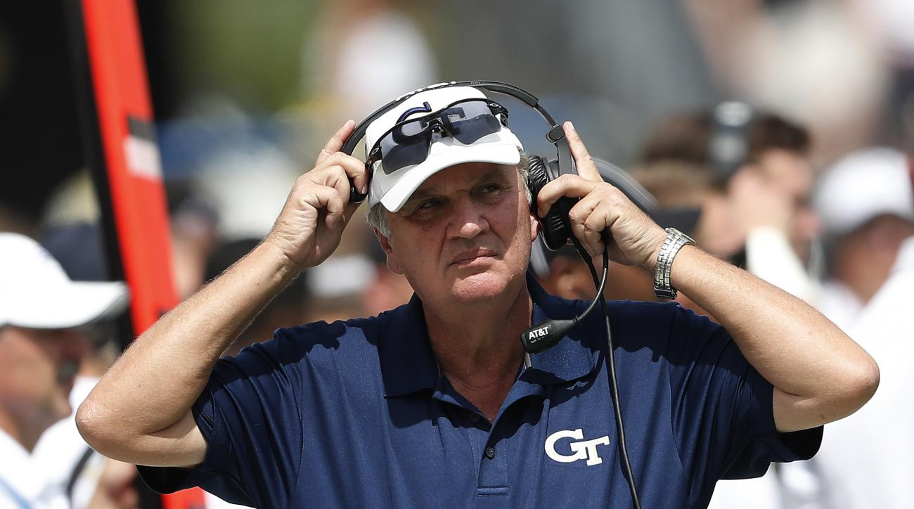 FILE - In this Sept. 17, 2016, file photo, Georgia Tech coach Paul Johnson adjusts his headset during the team's NCAA college football game against Vanderbilt in Atlanta. Considering Georgia Tech and Kentucky have two of the nations most prolific rushing
