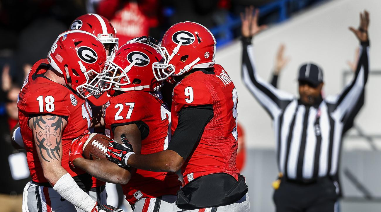 Georgia running back Nick Chubb (27) celebrates a fourth quarter touchdown against TCU in the Liberty Bowl NCAA college football game, Friday, Dec. 30, 2016, in Memphis, Tenn. (Mark Weber/The Commercial Appeal via AP)
