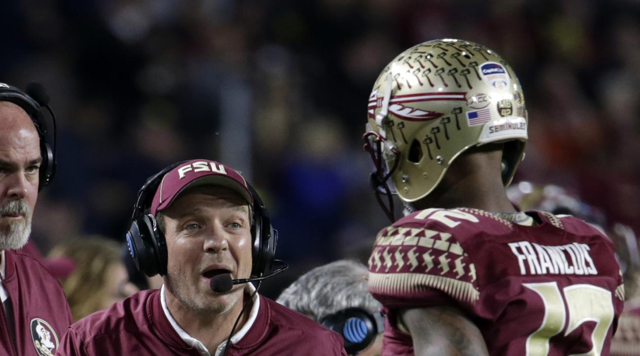 Florida State head coach Jimbo Fisher gestures to quarterback Deondre Francois, during the second half of the Orange Bowl NCAA college football game against Michigan, Friday, Dec. 30, 2016, in Miami Gardens, Fla. (AP Photo/Lynne Sladky)
