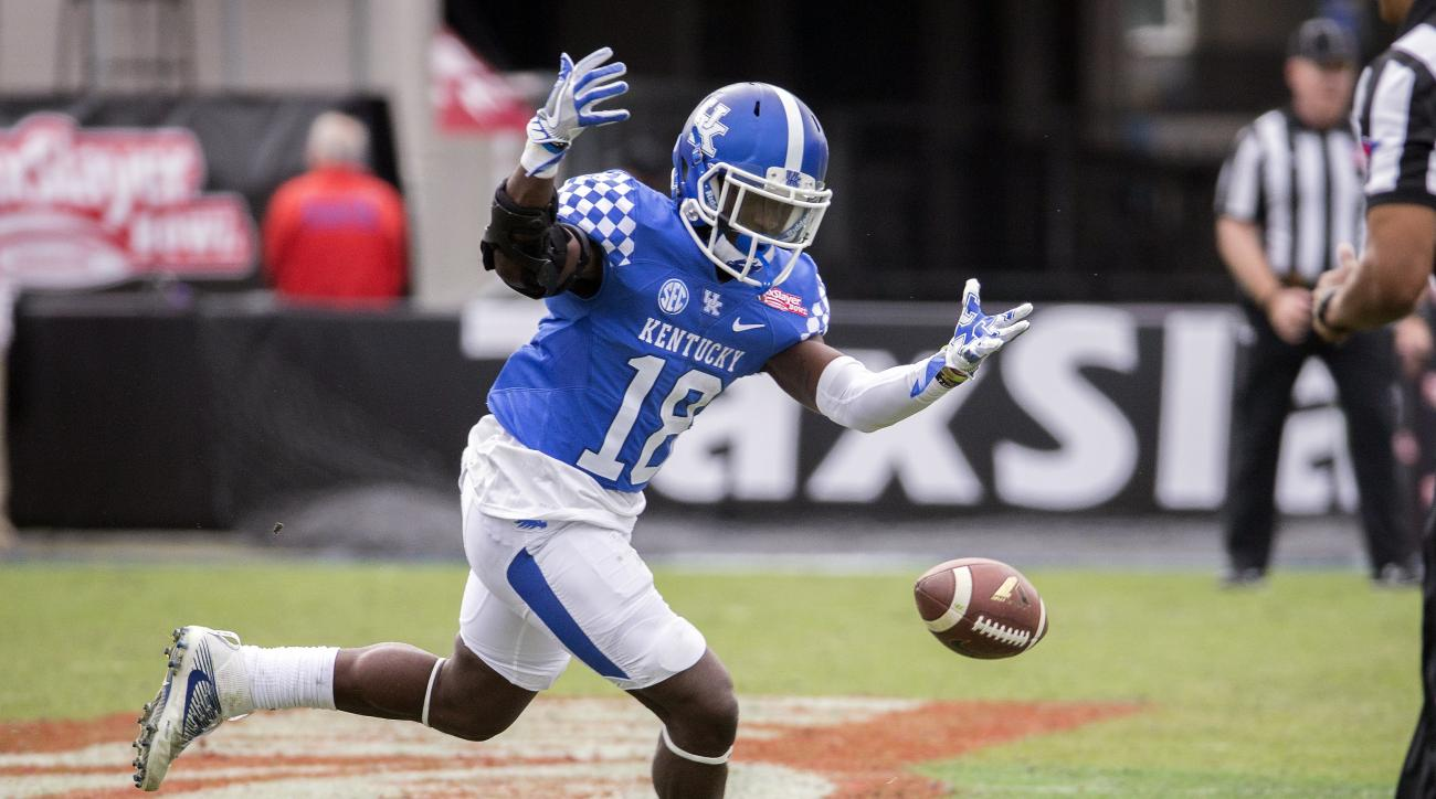 Kentucky running back Stanley Williams (18) drops a pass during the second half of the TaxSlayer Bowl NCAA college football game against Georgia Tech, Saturday, Dec. 31, 2016, in Jacksonville, Fla. Georgia Tech beat Kentucky 33-18. (AP Photo/Stephen B. Mo