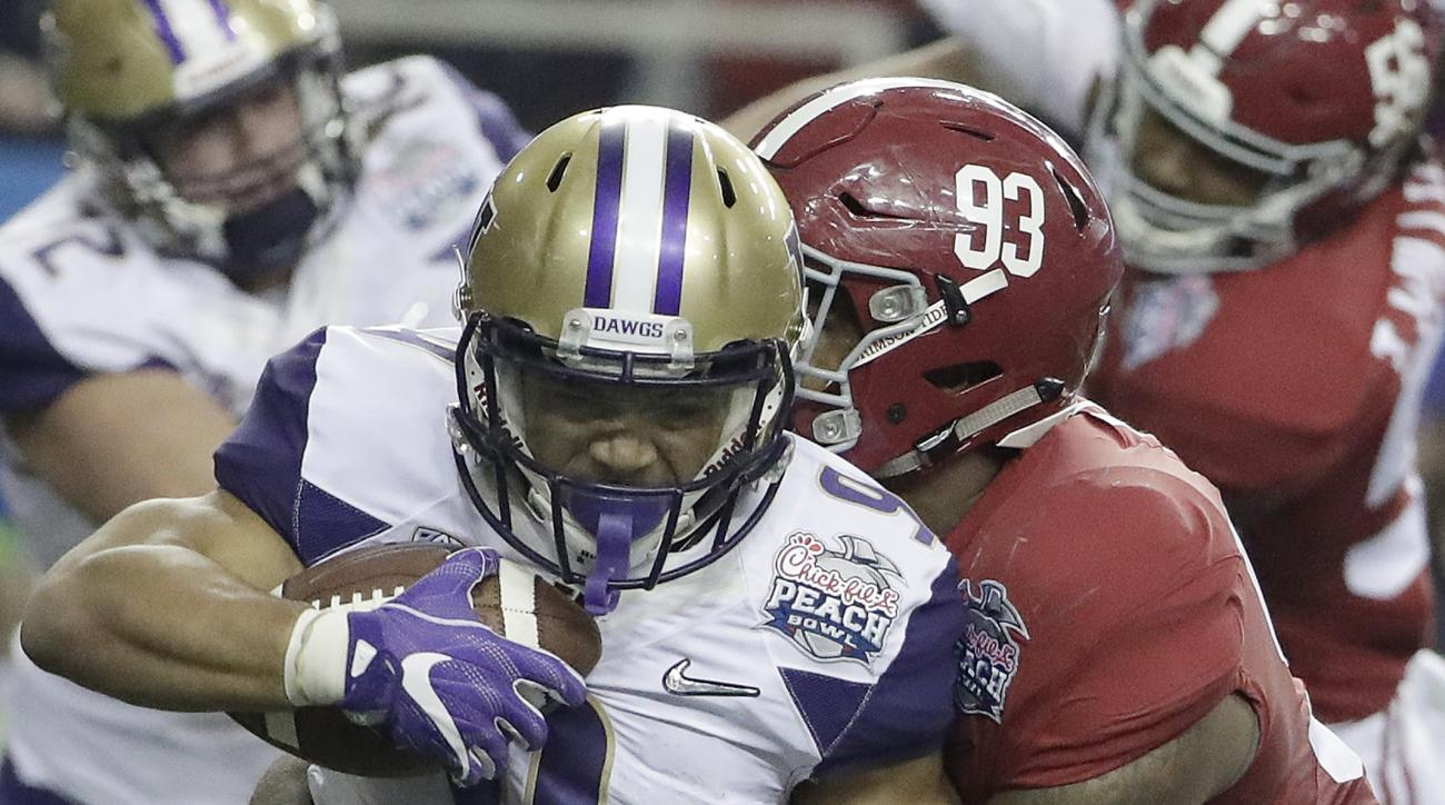 Alabama defensive lineman Jonathan Allen (93) tackles Washington running back Myles Gaskin (9) during the first half of the Peach Bowl NCAA college football playoff game, Saturday, Dec. 31, 2016, in Atlanta. (AP Photo/David Goldman)