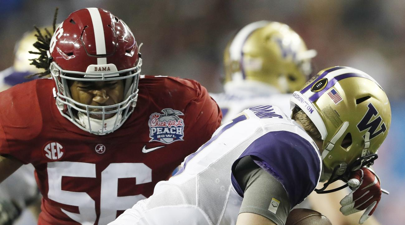 Alabama linebacker Tim Williams (56) sacks Washington quarterback Jake Browning (3) during the second half of the Peach Bowl NCAA college football playoff game, Saturday, Dec. 31, 2016, in Atlanta. (AP Photo/John Bazemore)