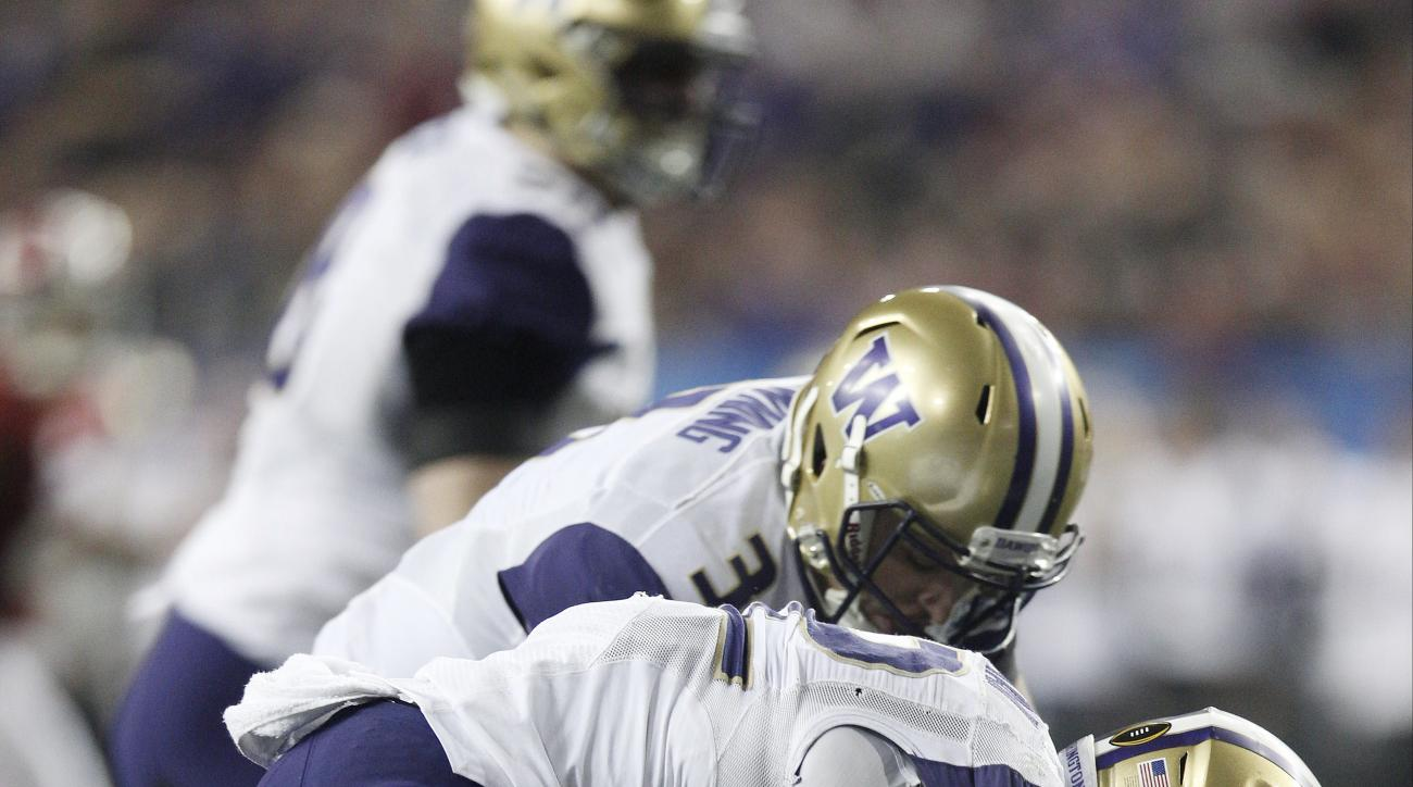 Washington quarterback Jake Browning (3) and Washington running back Lavon Coleman (22) work to recover a fumbled ball against Alabama during the second half of the Peach Bowl NCAA college football playoff game, Saturday, Dec. 31, 2016, in Atlanta. (AP Ph