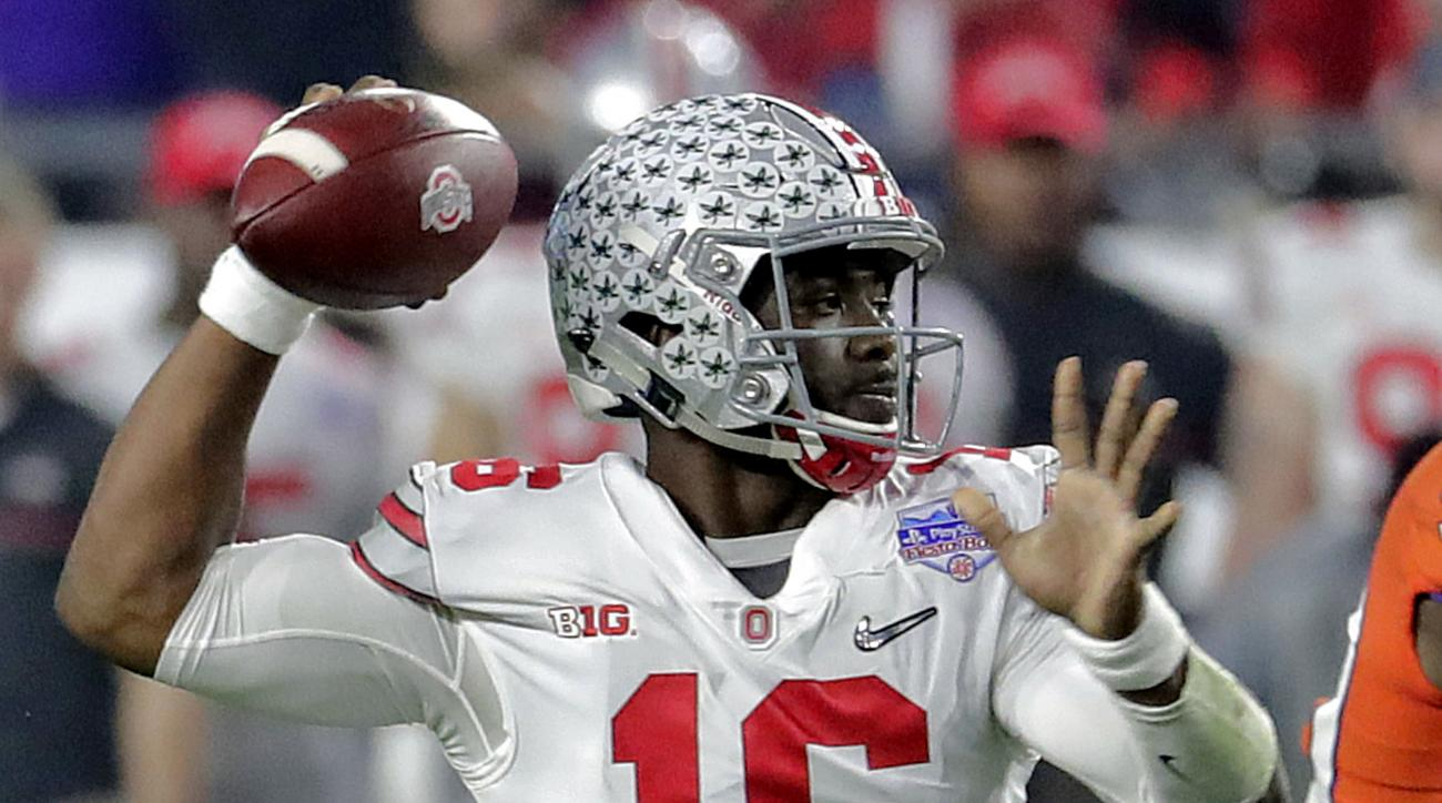 Ohio State quarterback J.T. Barrett (16) throws against Clemson during the first half of the Fiesta Bowl NCAA college football playoff semifinal, Saturday, Dec. 31, 2016, in Glendale, Ariz. (AP Photo/Rick Scuteri)