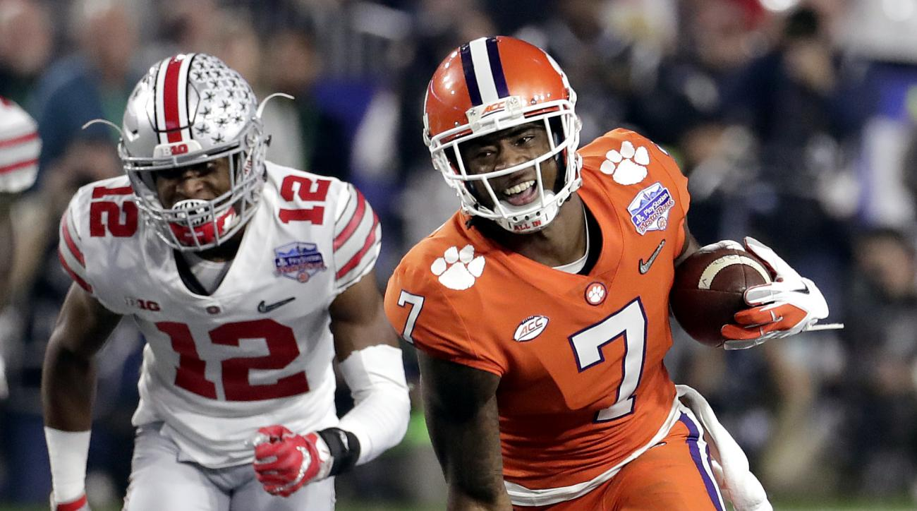 Clemson wide receiver Mike Williams (7) runs as Ohio State cornerback Denzel Ward (12) pursues during the first half of the Fiesta Bowl NCAA college football playoff semifinal, Saturday, Dec. 31, 2016, in Glendale, Ariz. (AP Photo/Rick Scuteri)