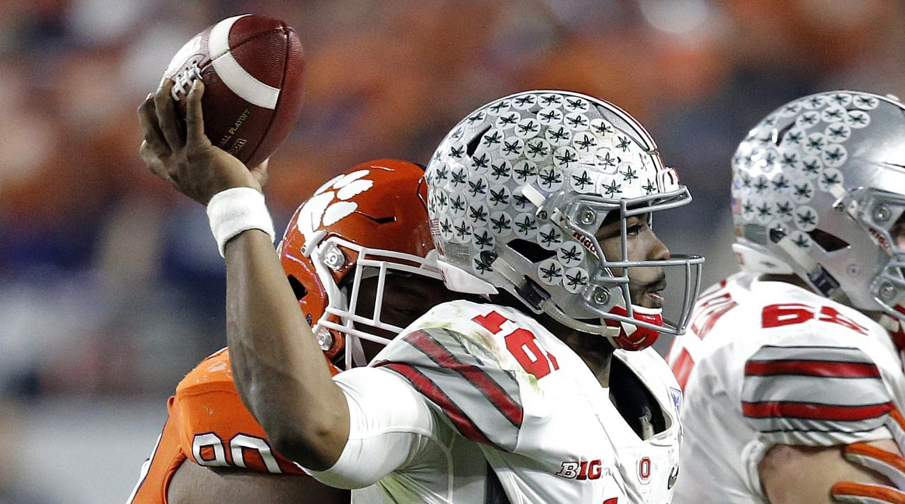 Ohio State quarterback J.T. Barrett (16) is hit by Clemson defensive tackle Dexter Lawrence during the first half of the Fiesta Bowl NCAA college football game, Saturday, Dec. 31, 2016, in Glendale, Ariz. (AP Photo/Ross D. Franklin)