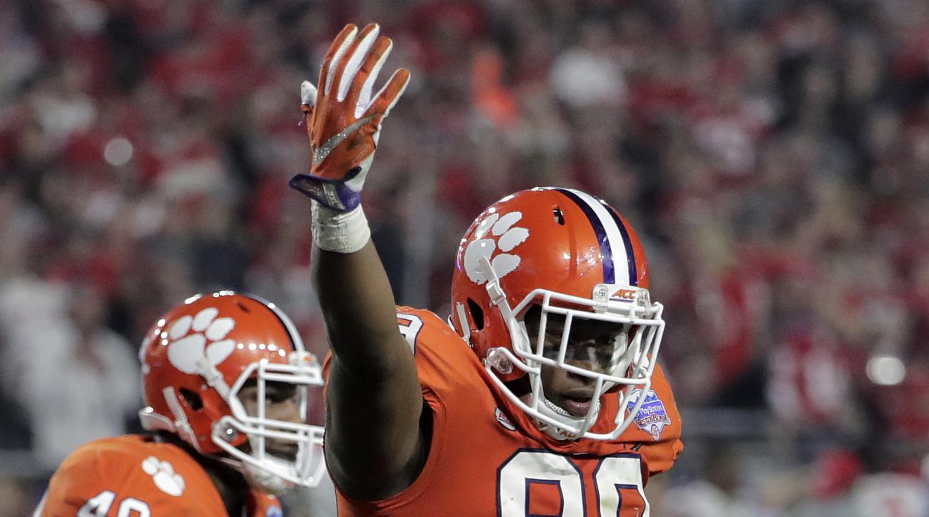 Clemson defensive end Clelin Ferrell (99) celebrate his sack against Ohio State during the second half of the Fiesta Bowl NCAA college football game, Saturday, Dec. 31, 2016, in Glendale, Ariz. (AP Photo/Rick Scuteri)