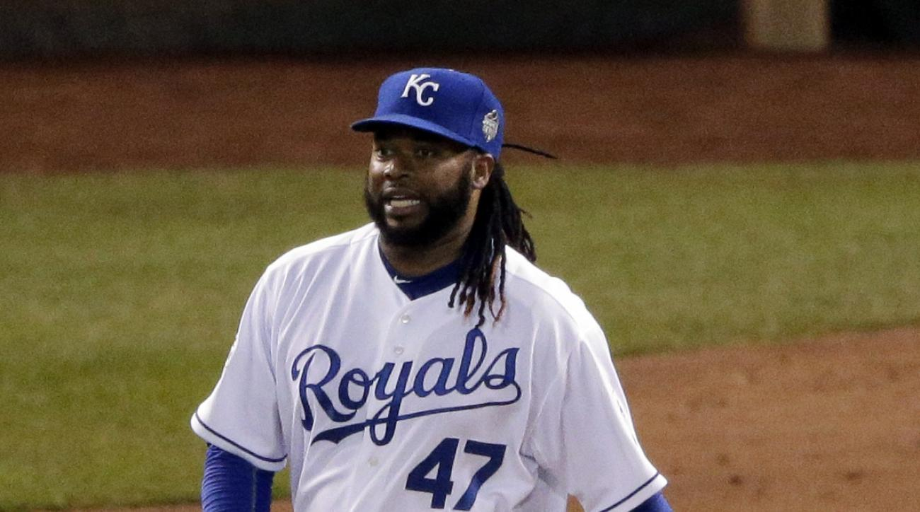 Kansas City Royals starting pitcher Johnny Cueto reacts after walking New York Mets' Daniel Murphy during the fourth inning of Game 2 of the Major League Baseball World Series Wednesday, Oct. 28, 2015, in Kansas City, Mo. (AP Photo/Charlie Riedel)