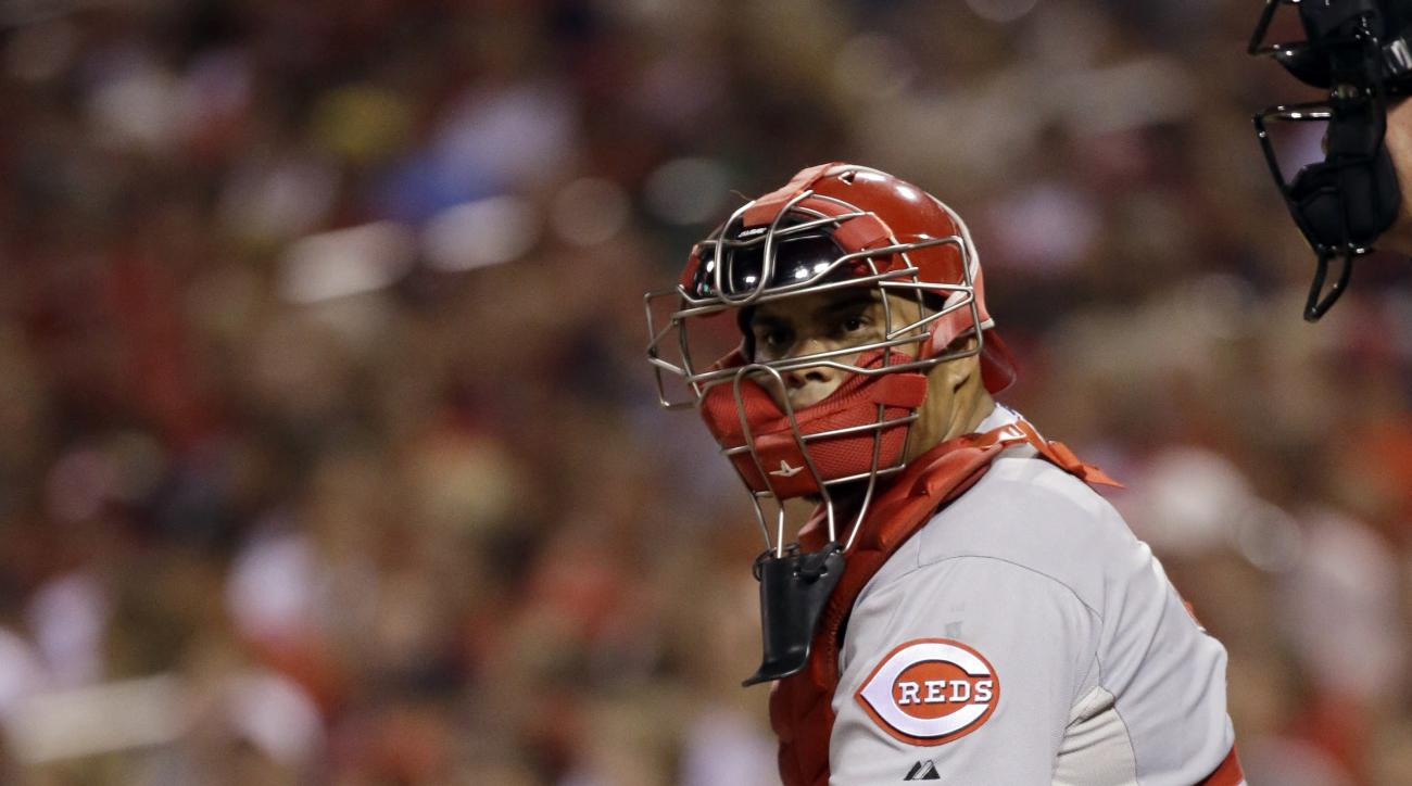 Cincinnati Reds catcher Brayan Pena looks into the dugout for a sign during the second inning of a baseball game against the St. Louis Cardinals on Tuesday, Sept. 22, 2015, in St. Louis. (AP Photo/Jeff Roberson)
