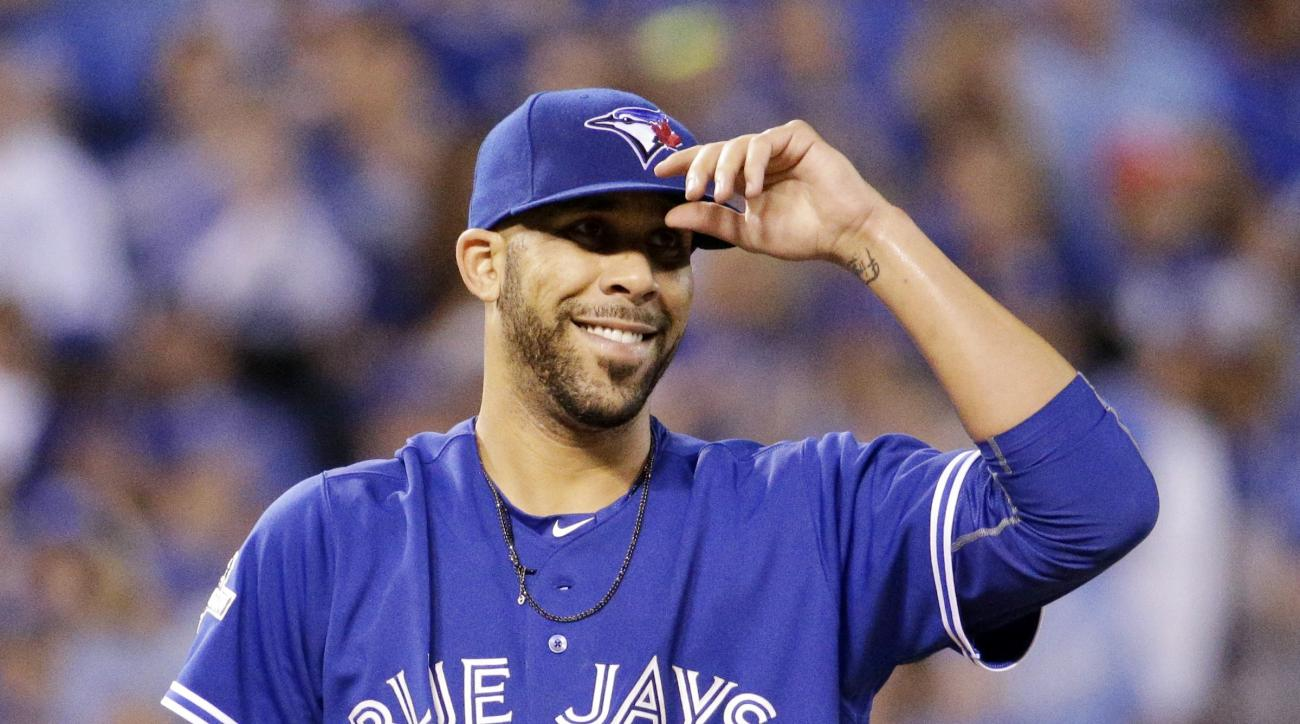 Toronto Blue Jays starting pitcher David Price smiles during the third inning in Game 6 of baseball's American League Championship Series against the Kansas City Royals on Friday, Oct. 23, 2015, in Kansas City, Mo. (AP Photo/Charlie Riedel)