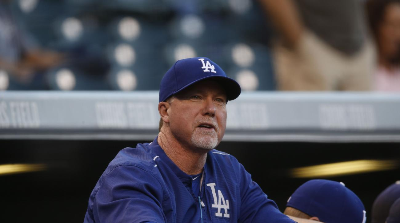 Los Angeles Dodgers batting coach Mark McGwire (25) looks on against the Colorado Rockies in the first inning of a baseball game Friday, Sept. 25, 2015, in Denver. (AP Photo/David Zalubowski)