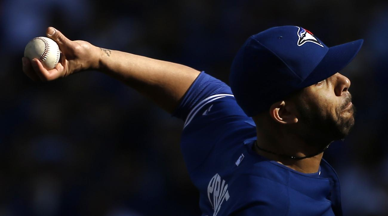 FILE - In this Oct. 17, 2015, file photo, Toronto Blue Jays starting pitcher David Price throws against the Kansas City Royals during the second inning in Game 2 of baseball's American League Championship Series, in Kansas City, Mo. The Boston Red Sox and