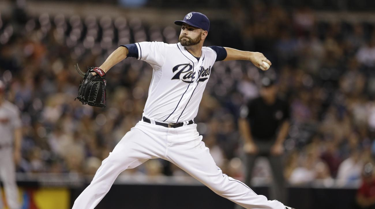 FILE - In this Sept. 25, 2015, file photo, San Diego Padres relief pitcher Marc Rzepczynski works against an Arizona Diamondbacks batter during the ninth inning of a baseball game, in San Diego. A person with knowledge of the deal says the San Diego Padre