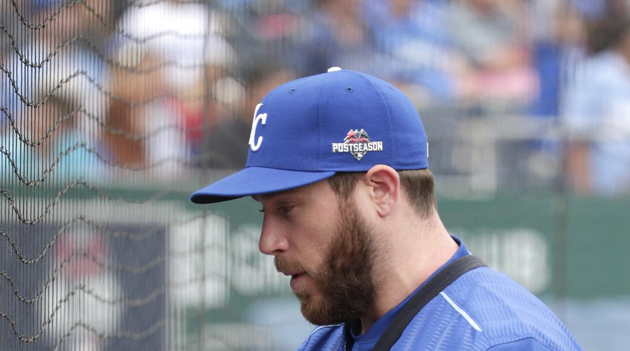 Kansas City Royals relief pitcher Greg Holland talks to fans during baseball practice Tuesday, Oct. 6, 2015, in Kansas City, Mo. The Royals face the winner of tonight's AL wildcard game Thursday in Kansas City. (AP Photo/Charlie Riedel)