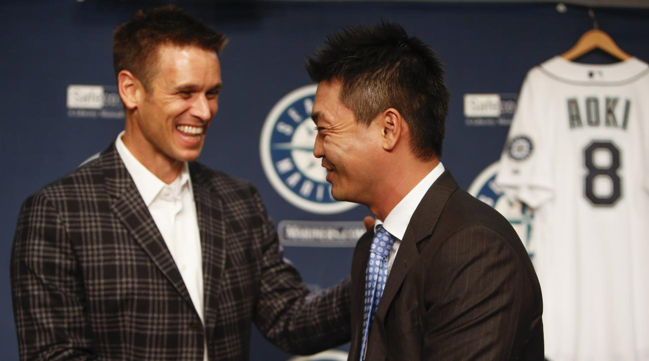 Seattle Mariners outfielder Nori Aoki, right, shakes hands with general manager Jerry Dipoto following a news press conference Thursday, Dec. 3, 2015, in Seattle. (AP Photo/Joe Nicholson)