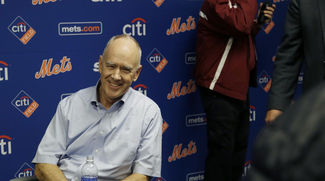 FILE - In this Nov. 4, 2015, file photo, New York Mets general manager Sandy Alderson rests in a chair after collapsing during a news conference in New York. Alderson will miss the annual GM meetings in Boca Raton, Fla., to undergo an unspecified medical