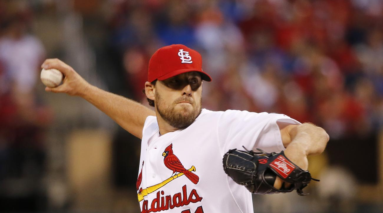 St. Louis Cardinals starting pitcher John Lackey throws during the first inning of Game 1 in baseball's National League Division Series against the Chicago Cubs, Friday, Oct. 9, 2015, in St. Louis. (AP Photo/Charles Rex Arbogast)