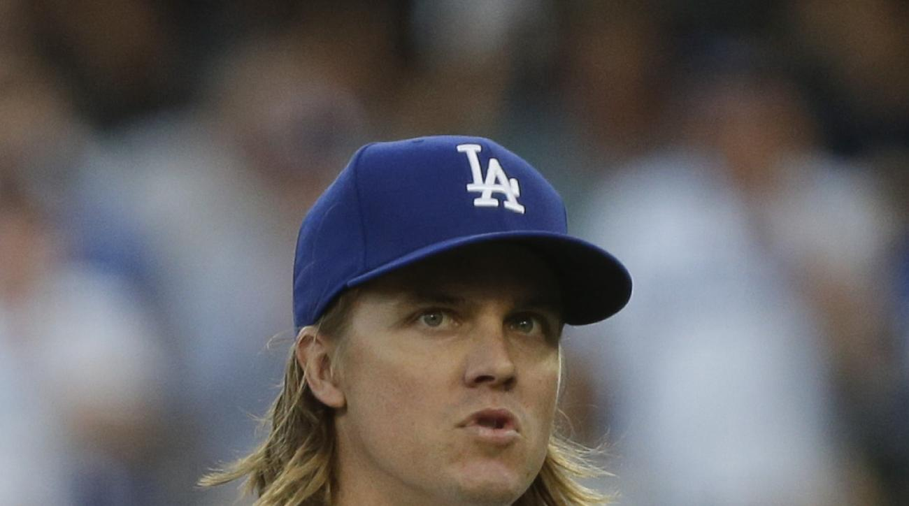 Los Angeles Dodgers starting pitcher Zack Greinke looks on while pitching against the New York Mets during the first inning in Game 5 of baseball's National League Division Series Thursday, Oct. 15, 2015, in Los Angeles. (AP Photo/Alex Gallardo)