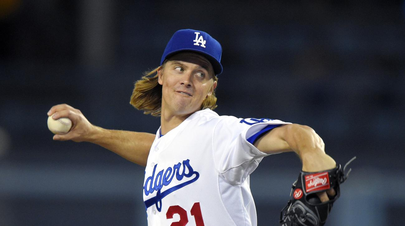 File - In this Sept. 18, 2015, file photo, Los Angeles Dodgers starting pitcher Zack Greinke throws to the plate during the first inning of a baseball game against the Pittsburgh Pirates in Los Angeles. A person with knowledge of the deal tells The Associ