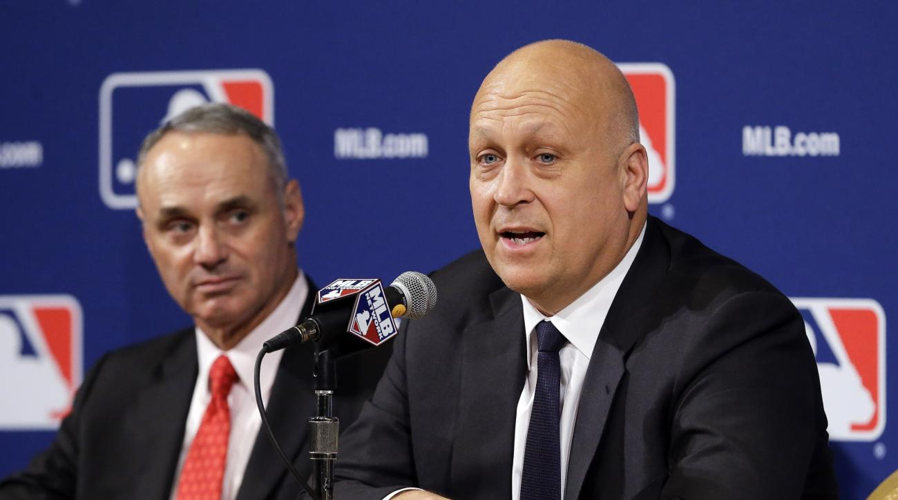 Former Baltimore Orioles shortstop and member of the Hall of Fame Cal Ripken Jr., right, speaks with Major League Baseball Commissioner Robert D. Manfred, Jr., left, at the MLB winter meetings, Monday, Dec. 7, 2015, in Nashville, Tenn. (AP Photo/Mark Hump