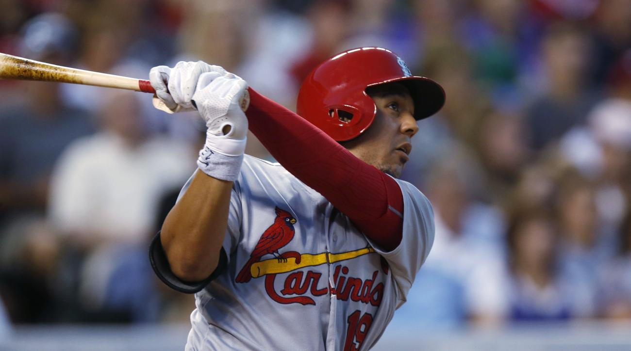 FILE - In this June 8, 2015, file photo, St. Louis Cardinals' Jon Jay follows the flight of his solo home run off Colorado Rockies starting pitcher David Hale in the sixth inning of a baseball, in Denver. The Cardinals have acquired infielder Jedd Gyorko