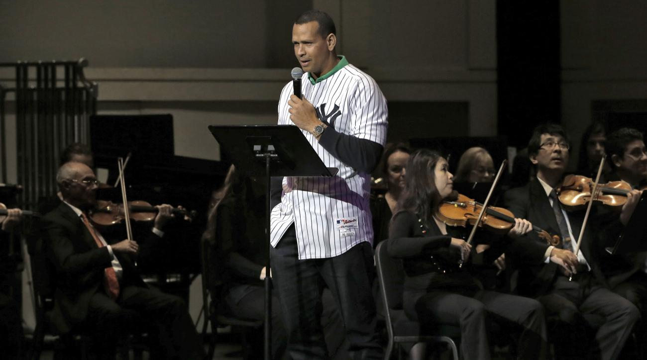 """New York Yankees' Alex Rodriguez is joined by The Florida Orchestra as he reads """"Twas the Night Before Christmas"""" to a group of Hillsborough and Pinellas County school children during the 27th Annual Steinbrenner  Family Children's Holiday Concert Tuesday"""