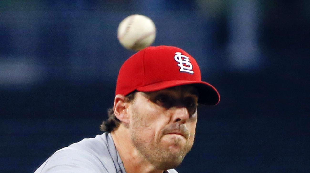 FILE - In this Aug. 21, 2015, file photo, St. Louis Cardinals starting pitcher John Lackey throws to a San Diego Padres batter during the first inning of a baseball game in San Diego. The Chicago Cubs and Lackey agreed, Tuesday, Dec. 8, 2015, on a two-yea