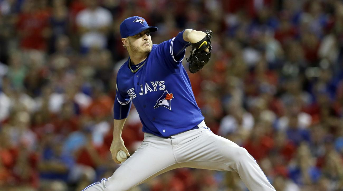 FILE - In this Oct. 11, 2015, file photo, Toronto Blue Jays relief pitcher Mark Lowe (57) reaches back to throw against the Texas Rangers during the seventh inning in Game 3 of baseball's American League Division Series in Arlington, Texas. The Detroit Ti