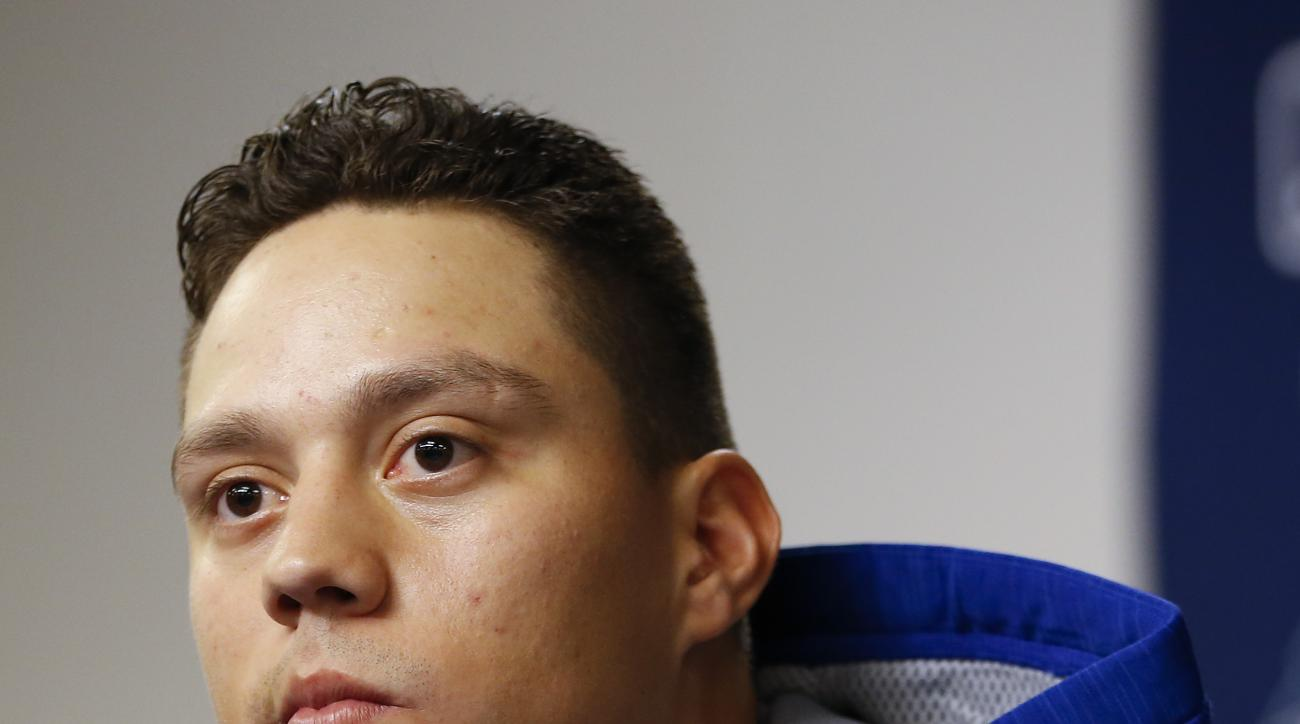 New York Mets' Wilmer Flores answers questions during a news conference before the start of baseball's Game 4 of the National League Division Series against the Los Angeles Dodgers, Tuesday, Oct. 13, 2015, in New York. (AP Photo/Kathy Willens)