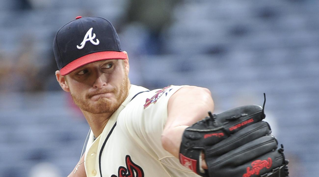 Atlanta Braves' Shelby Miller delivers a pitch against the St. Louis Cardinals during the first inning of the first baseball game of a doubleheader, Sunday, Oct. 4, 2015, in Atlanta. (AP Photo/John Amis)