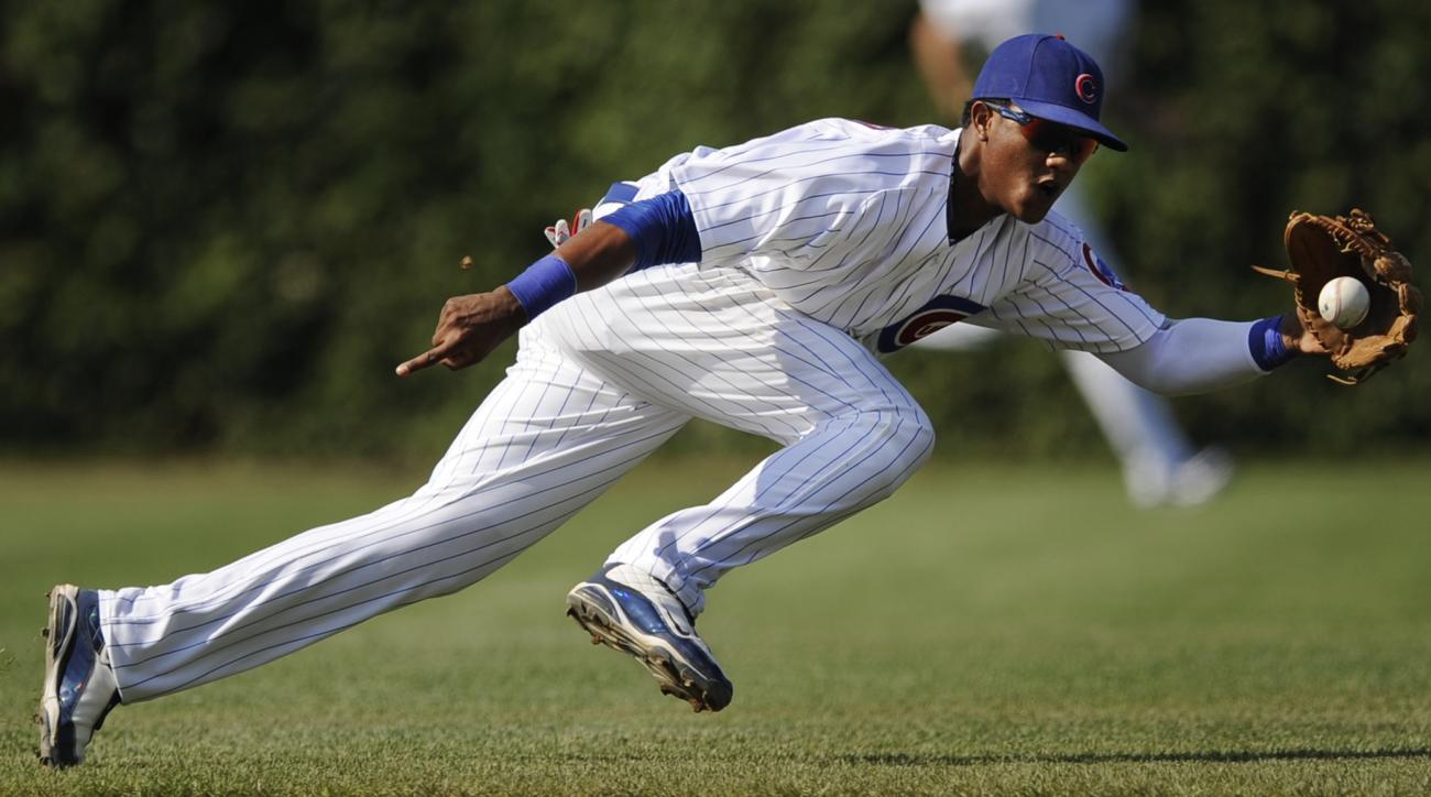 FILE - In this Aug. 21, 2010, file photo, Chicago Cubs shortstop Starlin Castro fields an infield single by Atlanta Braves' Jason Heyward during the third inning of a baseball game in Chicago. The Cubs traded Castro to the New York Yankees in exchange for