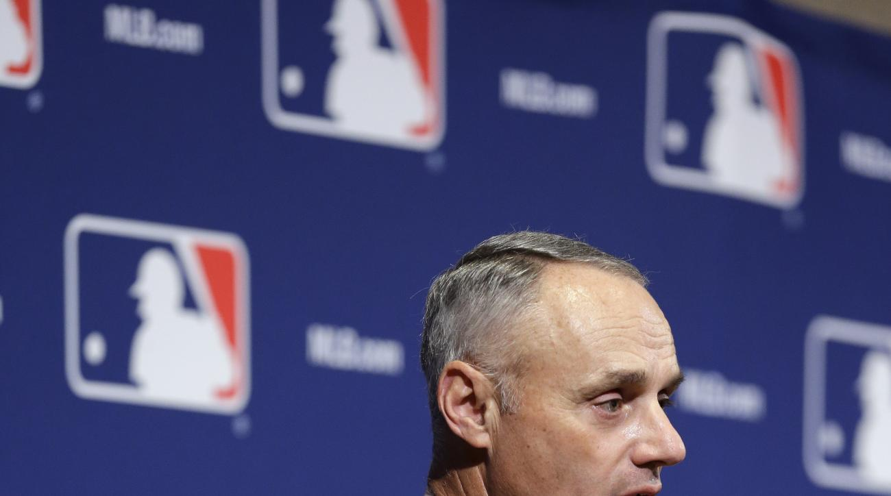 Baseball commissioner Robert D. Manfred, Jr.  speaks at the Major League Baseball winter meetings Monday, Dec. 7, 2015, in Nashville, Tenn. (AP Photo/Mark Humphrey)