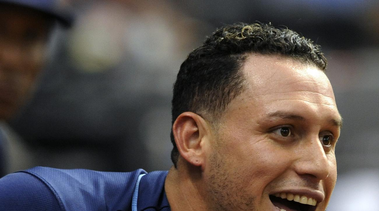 Tampa Bay Rays' Asdrubal Cabrera returns to the dugout after hitting a solo home run during a baseball game against the Toronto Blue Jays Saturday, Oct. 3, 2015, in St. Petersburg, Fla. (AP Photo/Steve Nesius)