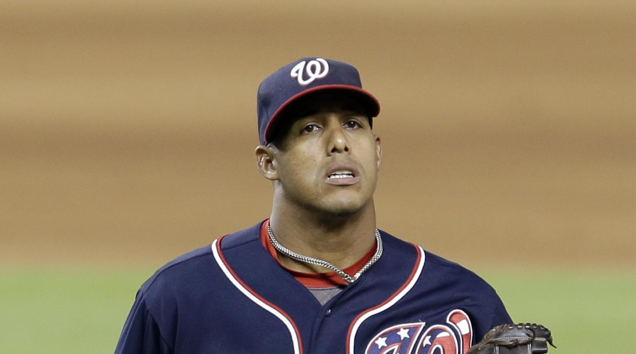 Washington Nationals third baseman Yunel Escobar (5) heads to the dugout during a baseball game against the Miami Marlins  Friday, Sept. 11, 2015, in Miami. (AP Photo/Alan Diaz)