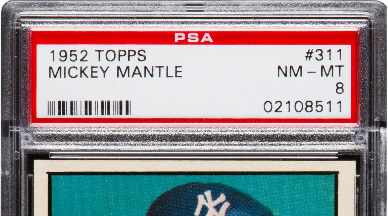 In this photo provided by Heritage Auctions, a rare Topps 1952 Mickey Mantle rookie card is displayed. The card has sold at auction for more than $500,000. Dallas-based Heritage Auctions said the pristine card has long been the most valuable postwar baseb