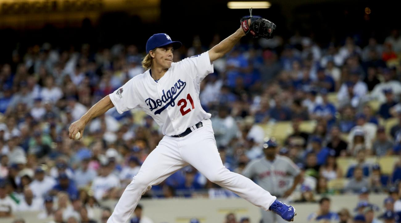 In this photo taken on Oct. 10, 2015, Los Angeles Dodgers starting pitcher Zack Greinke throws to the New York Mets during the first inning in Game 2 of baseball's National League Division Series,  in Los Angeles. Greinke could have stayed with the Los An