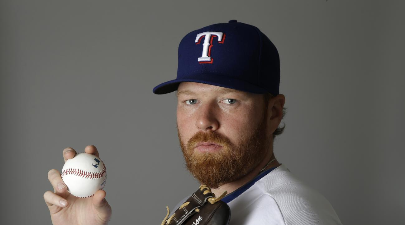 Texas Rangers' Tommy Hanson poses during photo day at spring training baseball practice, Tuesday Feb. 25, 2014, in Surprise, Ariz. (AP Photo/Tony Gutierrez)