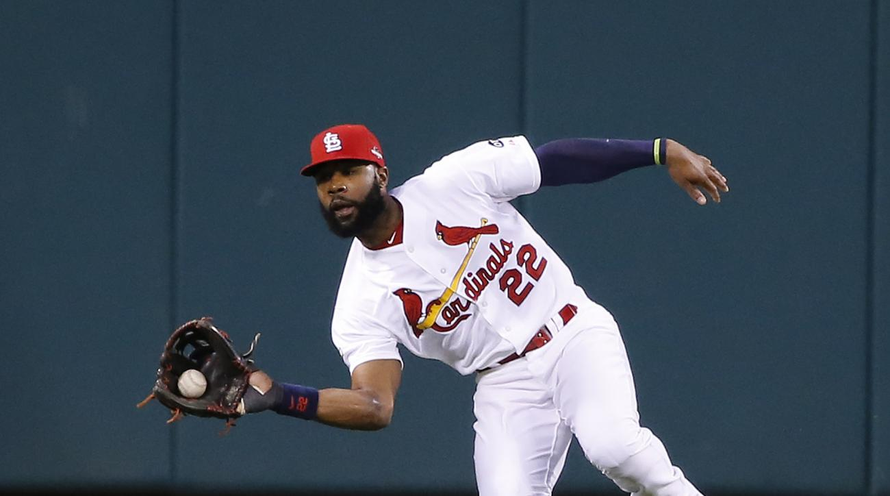 St. Louis Cardinals right fielder Jason Heyward catches a ball hit by Chicago Cubs' Addison Russell during the third inning of Game 1 in baseball's National League Division Series, Friday, Oct. 9, 2015, in St. Louis. (AP Photo/Charles Rex Arbogast)