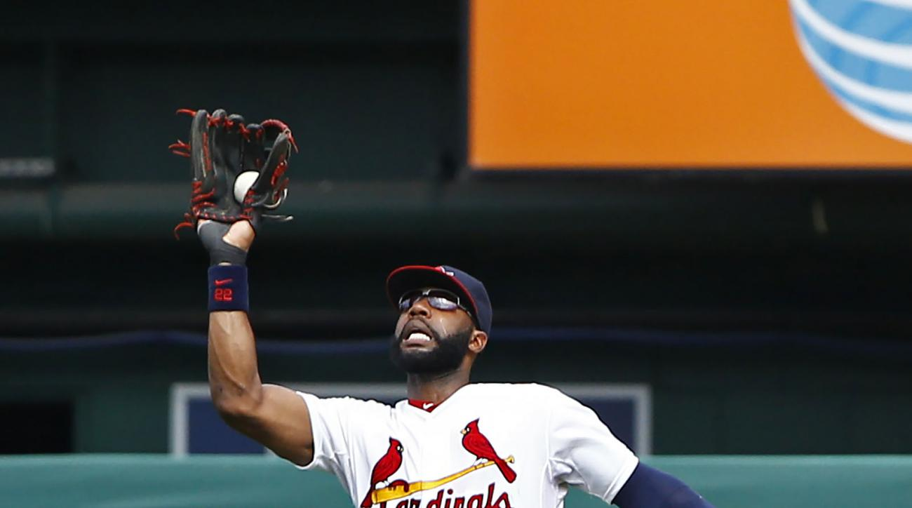 FILE - In this Sunday, July 26, 2015 file photo, St. Louis Cardinals right fielder Jason Heyward makes a leaping catch on a ball hit by Atlanta Braves' Nick Markakis during the ninth inning of a baseball game in St. Louis. A person familiar with the negot