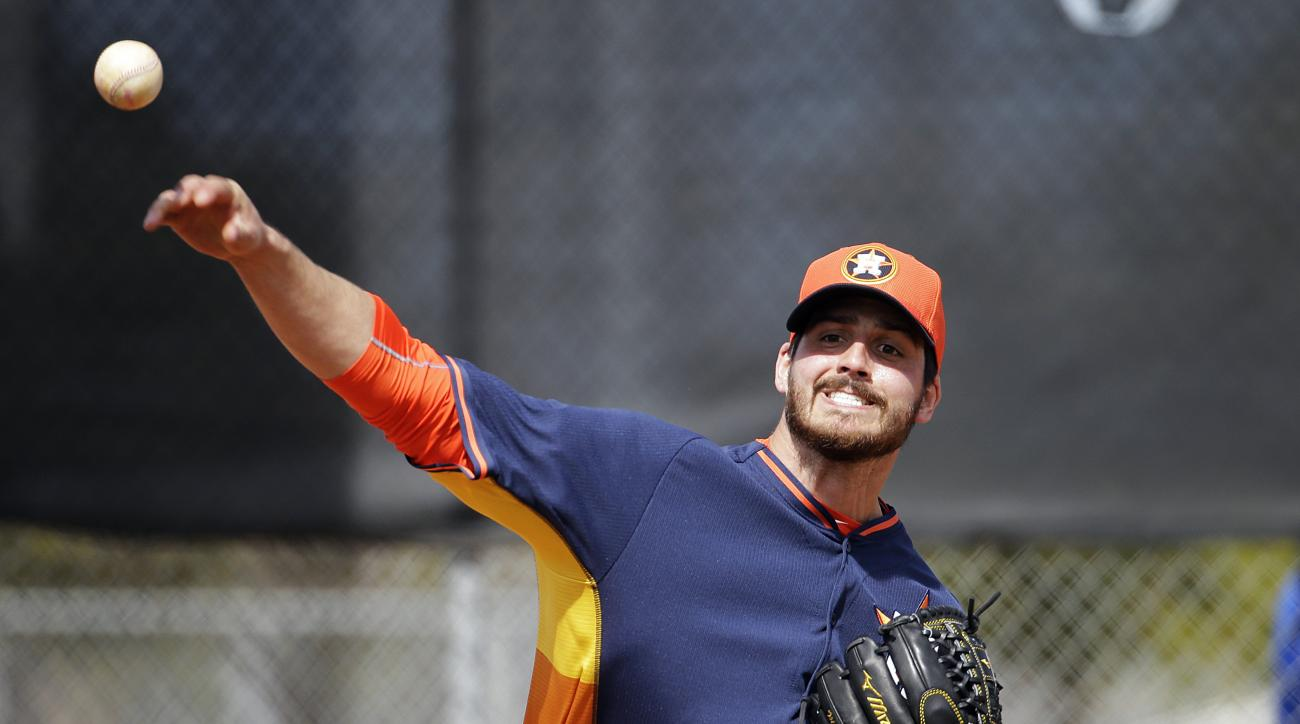 FILE - In tihs Feb. 21, 2015, file photoo, Houston Astros pitcher Mark Appel throws the ball during a spring training baseball workout in Kissimmee, Fla. Closer Ken Giles has been traded from the Phillies to Houston Astros as part of a seven-player deal t