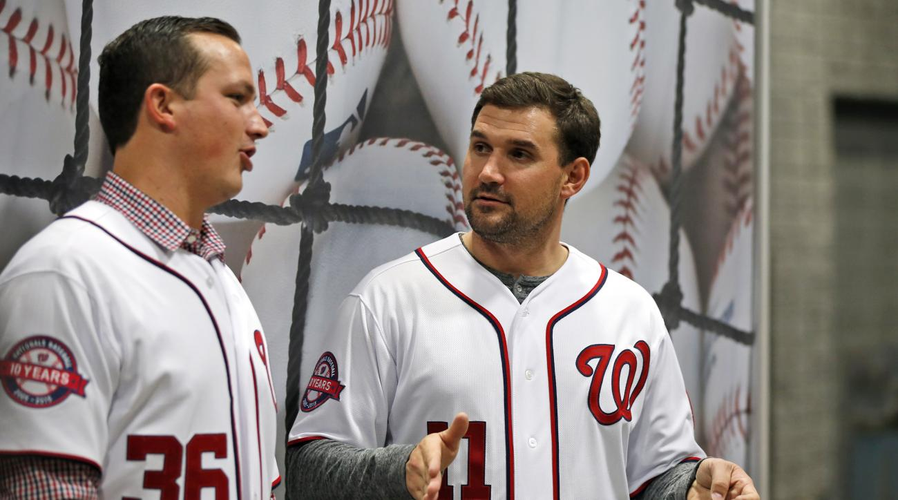 "Washington Nationals relief pitcher Sammy Solis, left, and first baseman Ryan Zimmerman talk between fan photos during the team's ""Winterfest"" baseball fan festival Saturday, Dec. 12, 2015, in Washington. (AP Photo/Alex Brandon)"